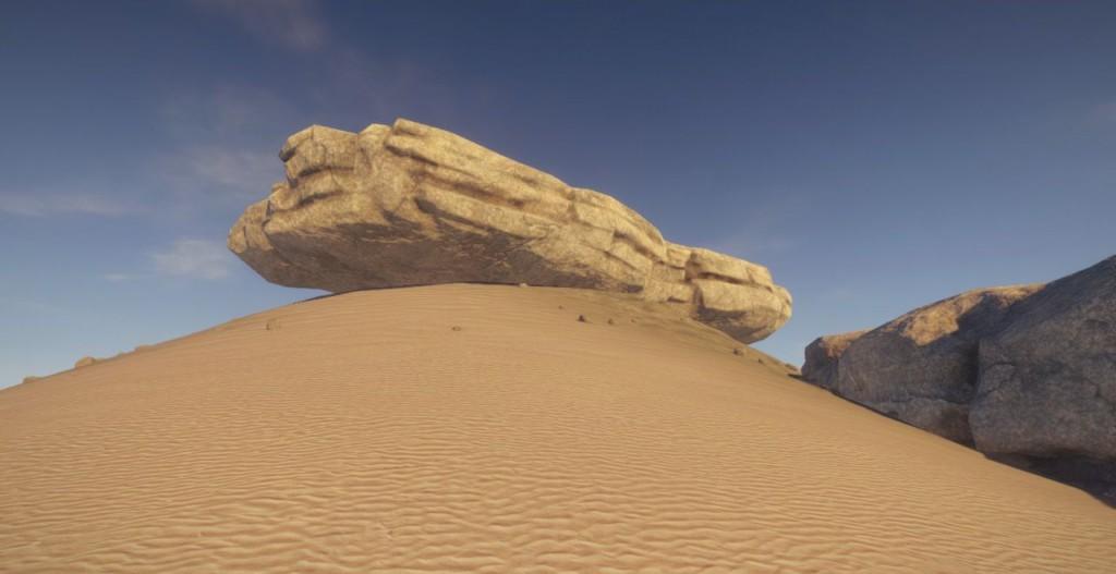 Булыжник на песчаном холме